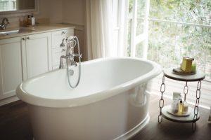 bathroom remodel with sunny window behind the bathtub